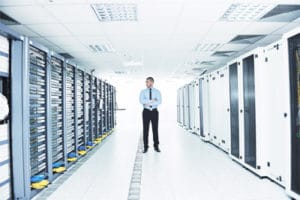 man standing in large data center
