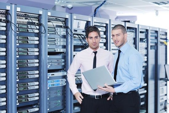 Two professionals discussing in server room