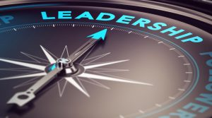 compass with needle pointing to Leadership