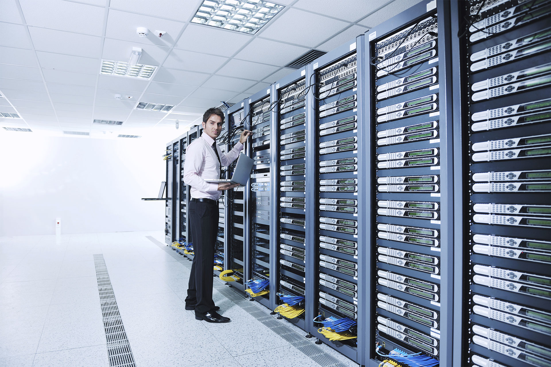 professional working in server room