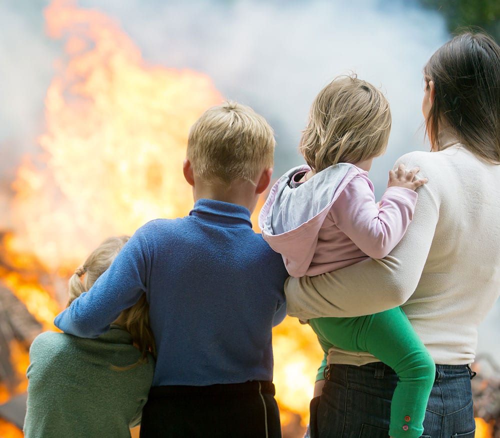Mother with children at burning house