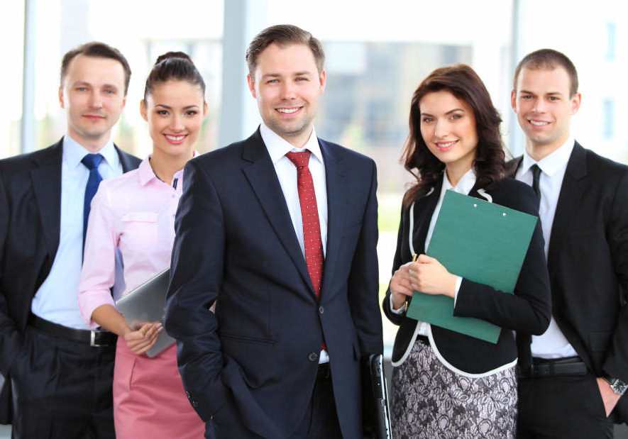 Group of smiling young professionals in an office